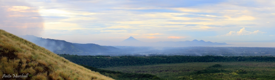 The view from the flanks of Masaya looking over the caldera. The peak in the background is Momotombo volcano.